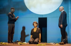 A scene from Antigone by Sophokles, directed by Ivo van Hove with Juliette Binoche, in a new translation by Anne Carson, at the BAM Harvey Theater on September 24, 2015. Actors: Juliette Binoche-Antigone Obi Abili_Black man Kirsty Bushell_Ismene_young women in skirt Samuel Edward-Cook_Haimon- Young bald man Finbar Lynch_Teiresias_Small thin wiry Patrick O'Kane_Kreon_bald man in suit Kathryn Pogson_Eurydike_older woman Nathaniel Jackson_dead body Credit: Stephanie Berger